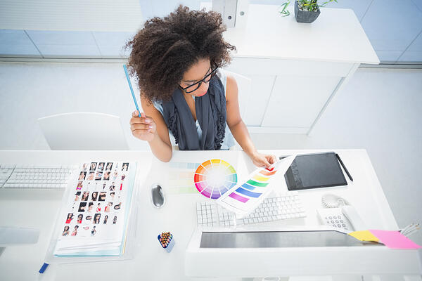 Pretty designer working at her desk in her office
