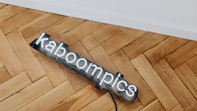 The Kaboompics Logo On A Lighting Mount